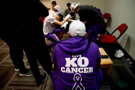 "Dedicating his fights to community causes has become a staple for Ramirez and his manager, Rick Mirigian. Billed as the fight to ""KO Cancer,"" Ramirez wore purple gloves and vis"