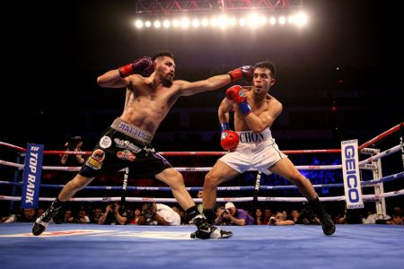 Alumnus Jose Ramirez (left) successfully defended his WBO super lightweight title in front of 14,000-plus fans at the Save Mart Center in February.