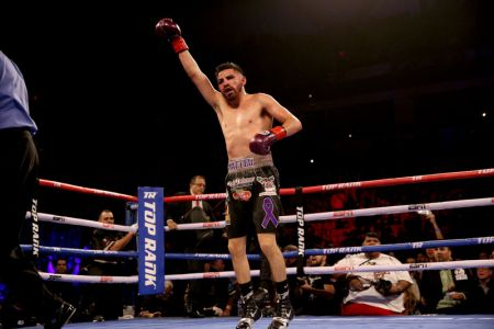 Ramirez battled through adversity, including a cut near his eye, to raise his hand and retain the title belt in front of a crowd that helped lift him to victory with support during the critical moments.