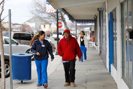 Nurse With Patient On A Street