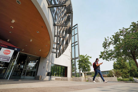 A student exits the Madden Library