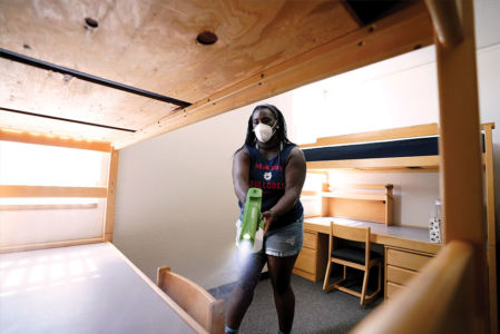 Kiara Graves helped clean dorm-room desks